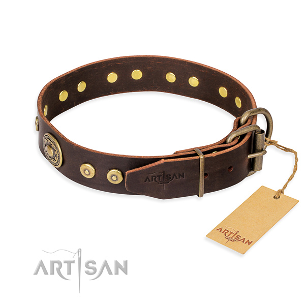 Leather dog collar made of gentle to touch material with rust-proof embellishments